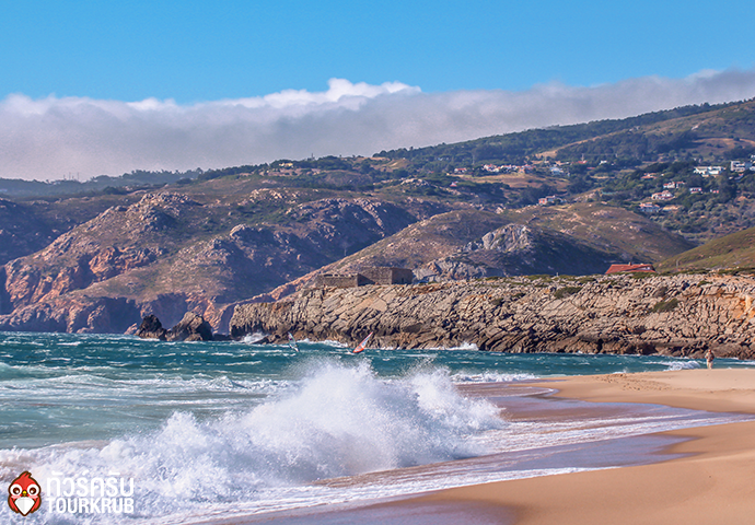 Summer beach with waves crashing on shore in Guincho, Cascais in Portugal
